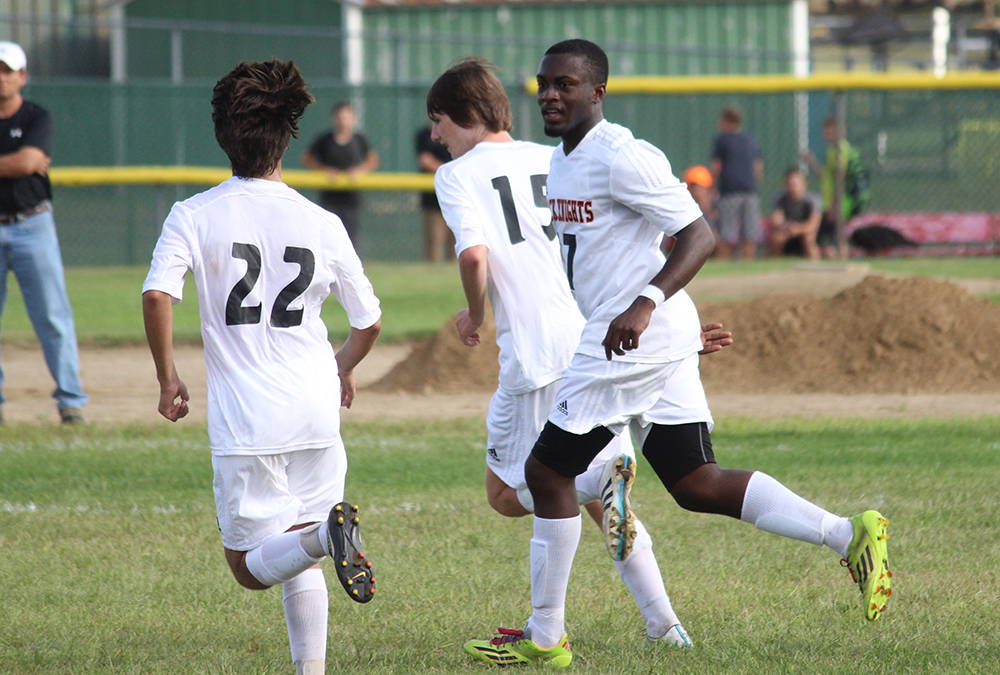 Loubensky Lucas celebrates his first half goal with teammates. (Ryan Lanigan/HockomockSports.com)