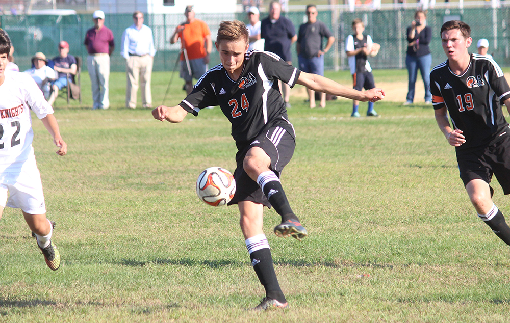 Oliver Ames' Cam Vella clears the ball in the first half against Stoughton. (Ryan Lanigan/HockomockSports.com)