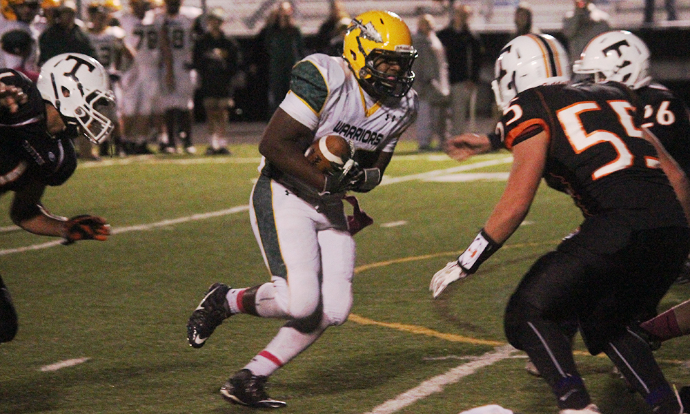 King Philip junior Gio Fernandez carries the ball in the first quarter against Taunton. (Ryan Lanigan/HockomockSports.com)