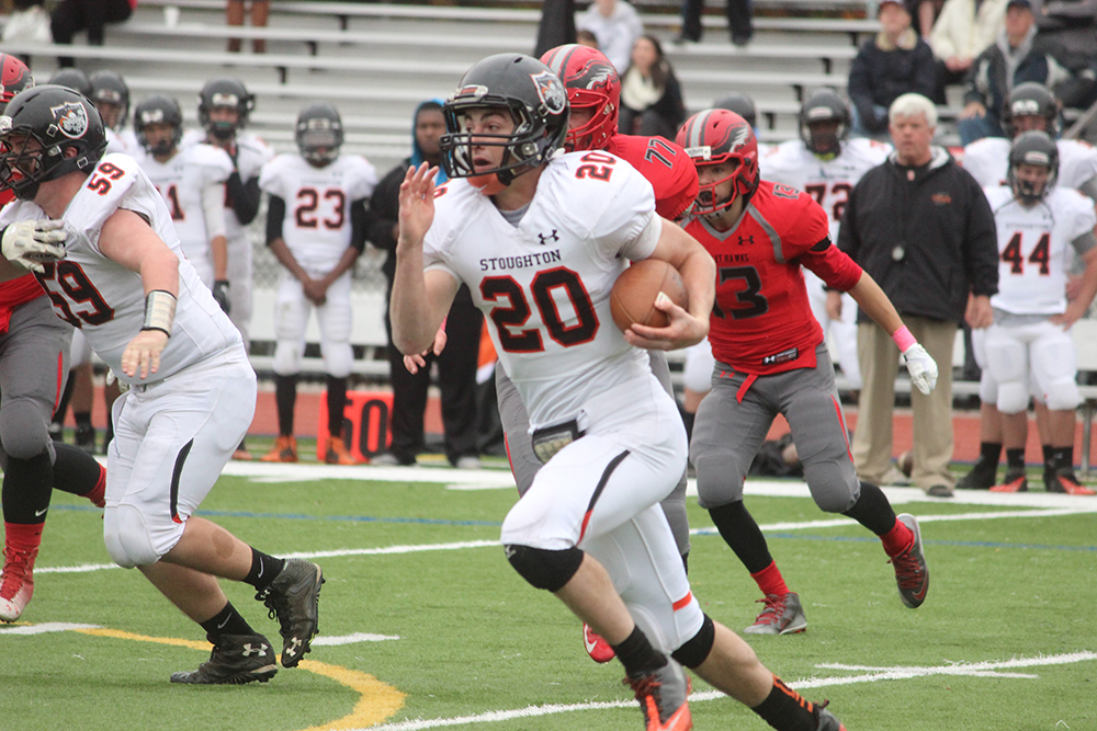 Stoughton junior Ryan Sullivan (95 yards, two touchdowns) carries the ball in the first half against Milford. (Ryan Lanigan/HockomockSports.com)