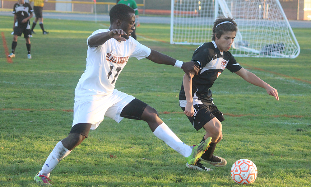 Stoughton's Loubensky Lucas challenges for possession in the second half. (Ryan Lanigan/HockomockSports.com)