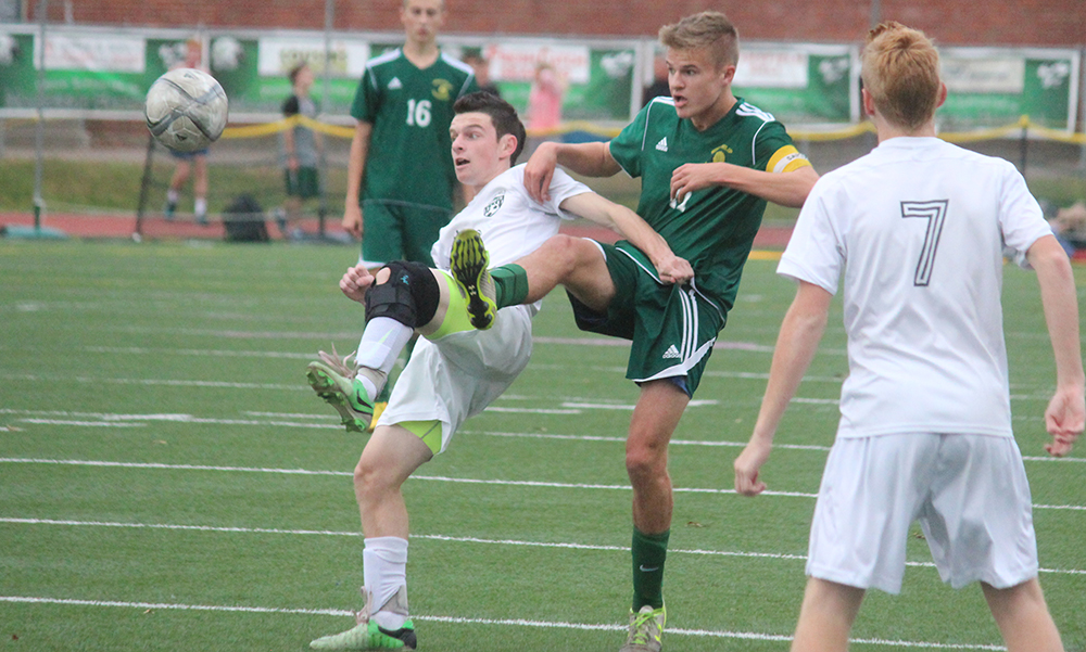 Mansfield's Jared Miller and King Philip's Joe Kellett battle for possession in the first half. (Ryan Lanigan/HockomockSports.com)
