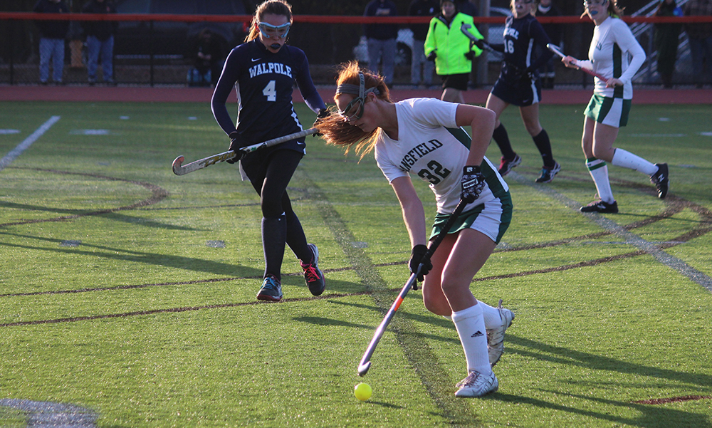 Mansfield's Caitlin Whitman carries the ball up field in the second half at Muscato Stadium. (Ryan Lanigan/HockomockSports.com)