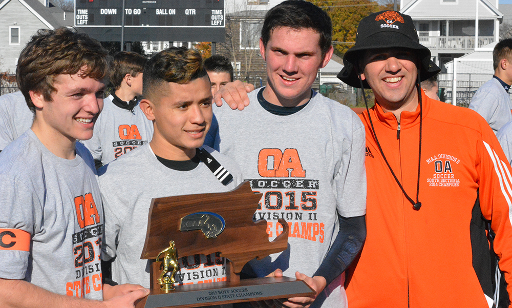 Oliver Ames captains Max Bamford, Chris Romero, Keegan Nutt and head coach John Barata with the D2 State Championship. (Josh Perry/HockomockSports.com)