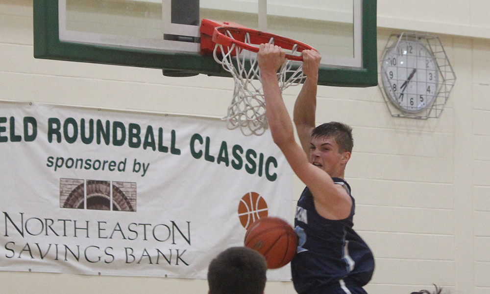 Franklin's Connor Peterson hangs on the rim after a two handed dunk in the second half. (Ryan Lanigan/HockomockSports.com)