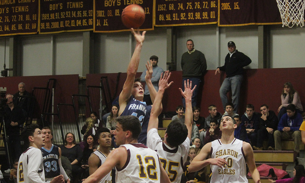 Franklin sophomore Connor Peterson releases a shot in the first half in a sea of Sharon defenders. (Ryan Lanigan/HockomockSports.com)