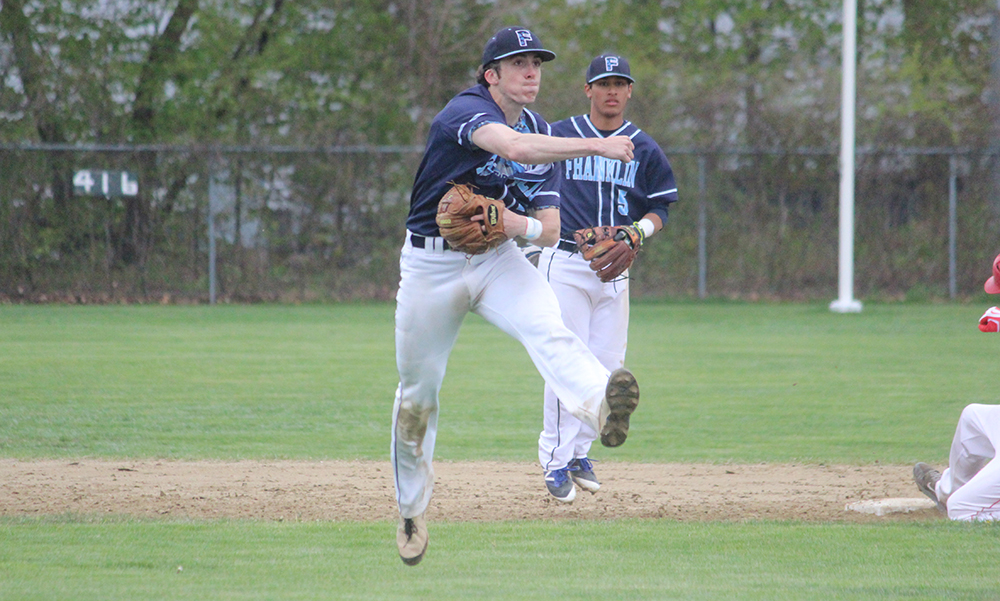 Franklin senior shortstop Nick Santucci, who had three RBI, throws a runner out at first. (Ryan Lanigan/HockomockSports.com)