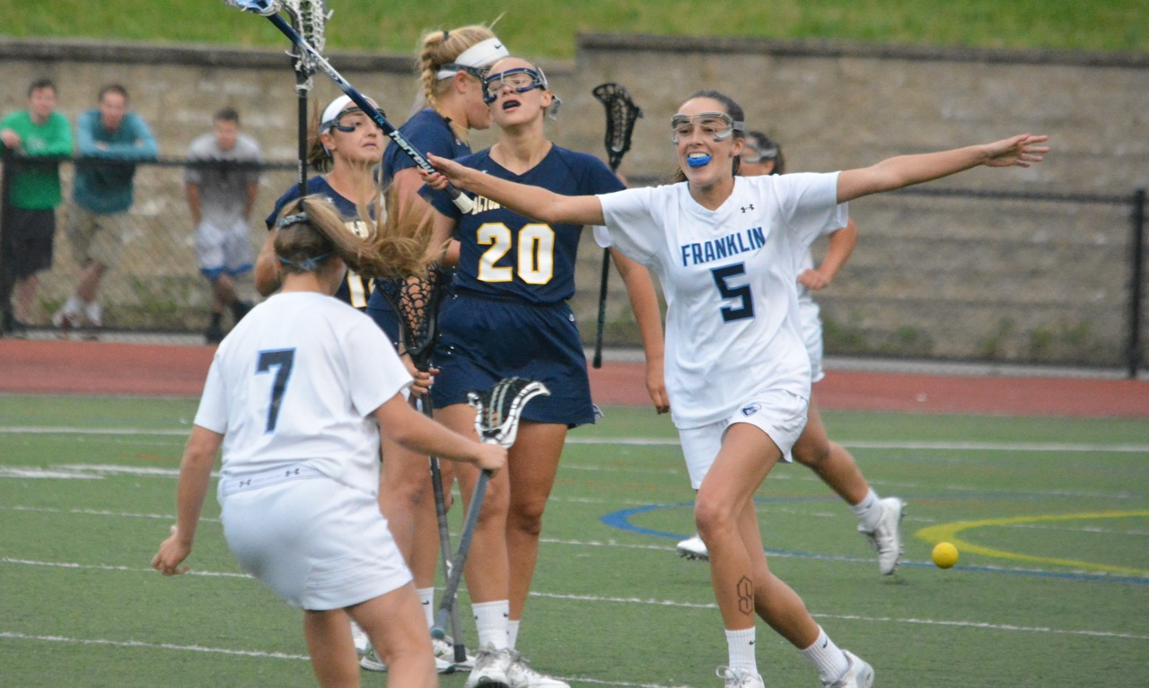 Kendall Reardon (5) celebrates at the final whistle, as Franklin held off Acton-Boxboro to win the Div. 1 East title. (Josh Perry/HockomockSports.com)