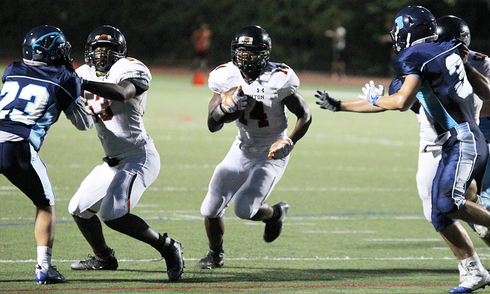 Stoughton senior Izon Swain-Price bursts through a big gap created by his offensive line. (Ryan Lanigan/HockomockSports.com)