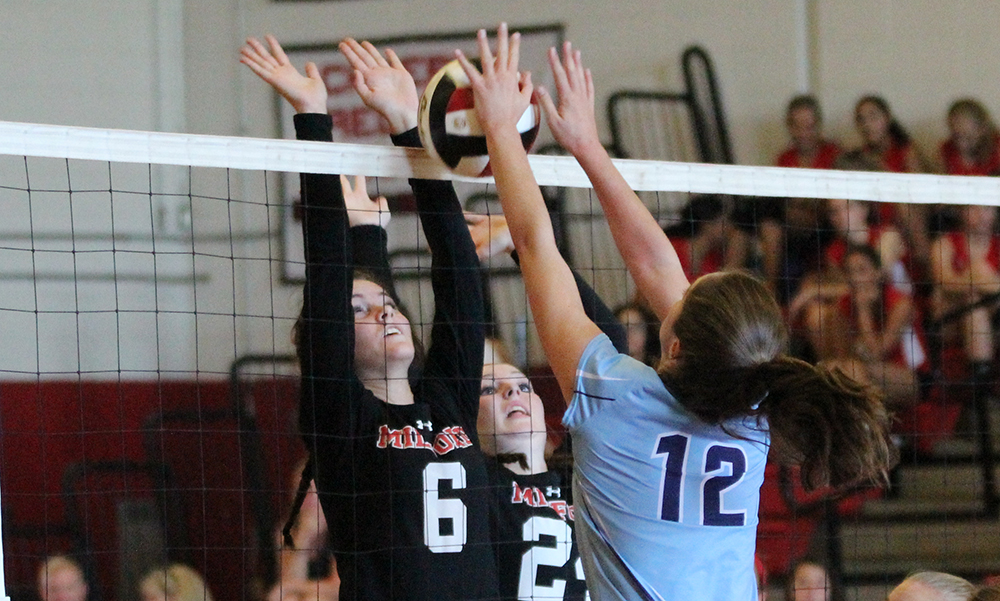 Milford's Brianna Croteau and Juliana Tracy go up for a block against Franklin's Erin Skidmore. (Ryan Lanigan/HockomockSports.com)