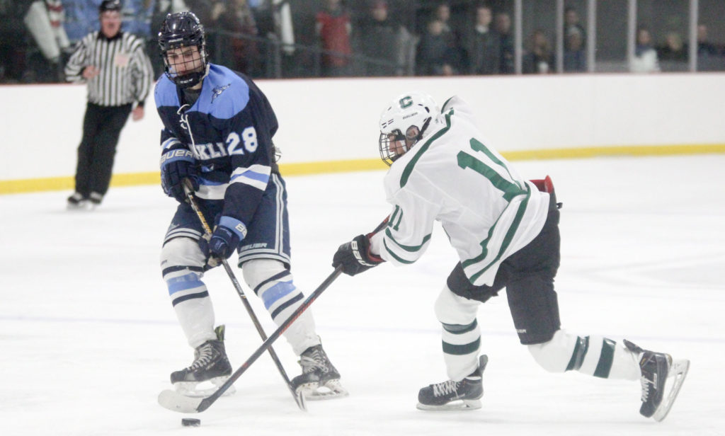 Franklin's Brendan O'Rielly and Canton's Jack Goyetch battle for possession. (Ryan Lanigan/HockomockSports.com)