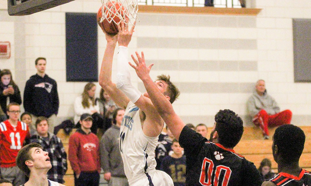 Franklin's Connor Peterson goes for a layup in the first half against Taunton. (Ryan Lanigan/HockomockSports.com)