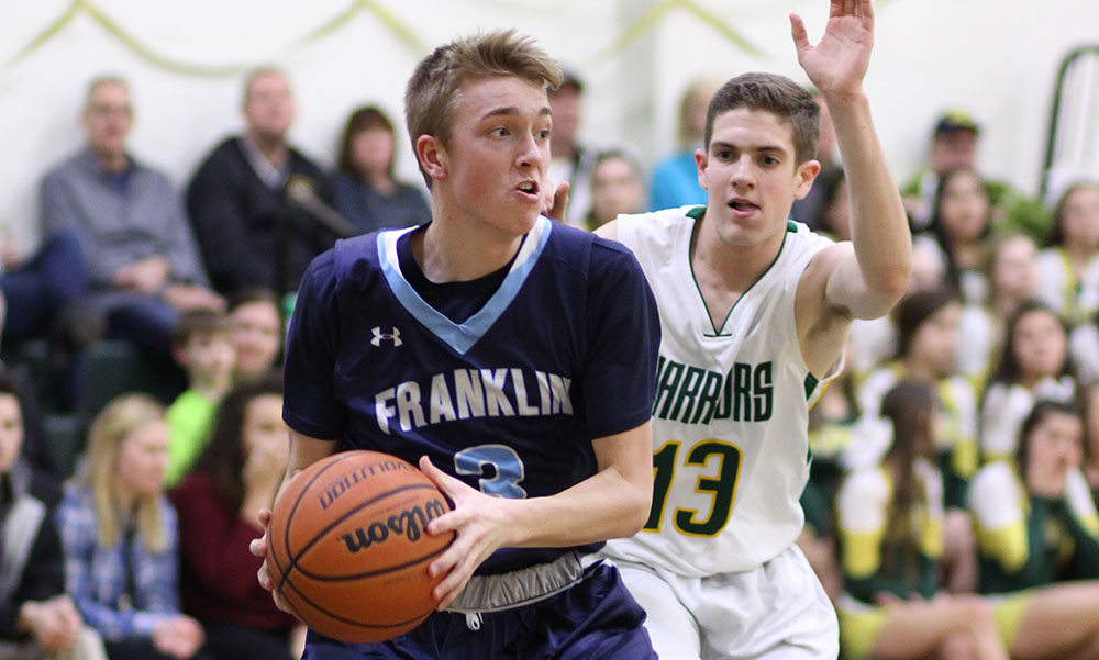 Franklin freshman Chris Edgehill attacks the basket against King Philip. (Peter Raider/HockomockSports.com Student Photographer)