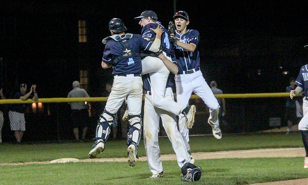 Franklin's Jake Macchi (left), Bryan Woelfel and Alex Haba (right) converge with Jake Noviello following the final out. (Ryan Lanigan/HockomockSports.com)