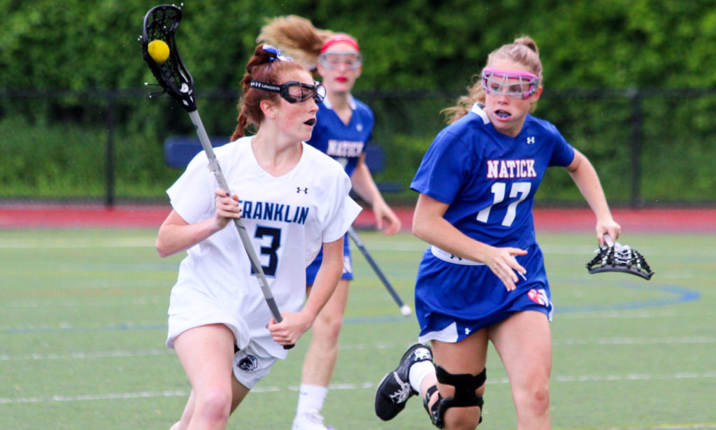 Franklin's Annie Walsh races past a Natick defender in the first half. (Peter Raider/HockomockSports.com Student Photographer)