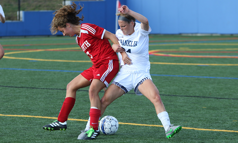 North Attleboro's Ashlyn Gaulin and Franklin's Molly O'Rielly battle for possession in the second half. (Ryan Lanigan/HockomockSports.com)