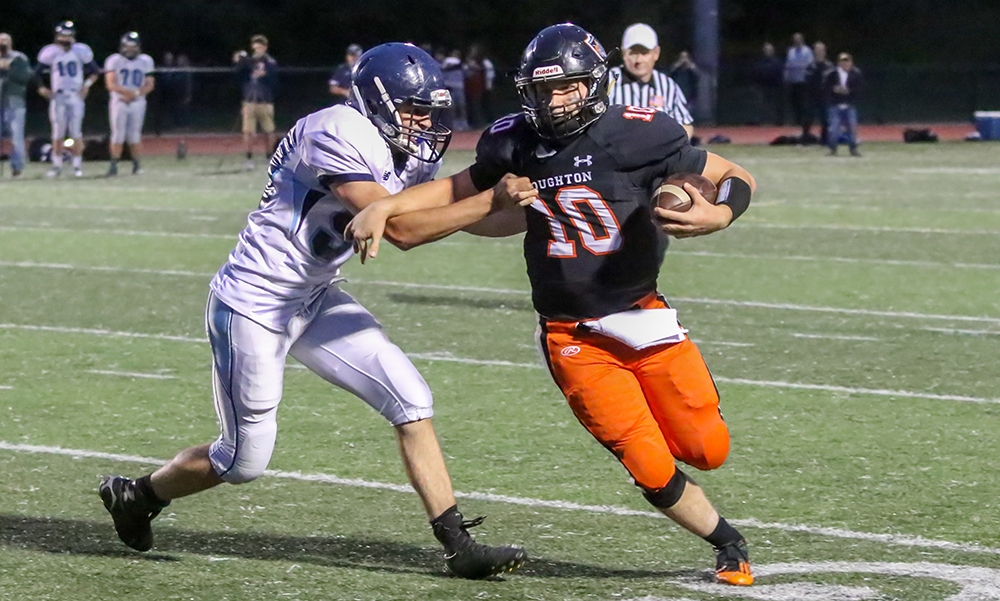 Stoughton's Evan Gibb (right) tries to avoid a tackle in the first half. (Ryan Lanigan/HockomockSports.com)