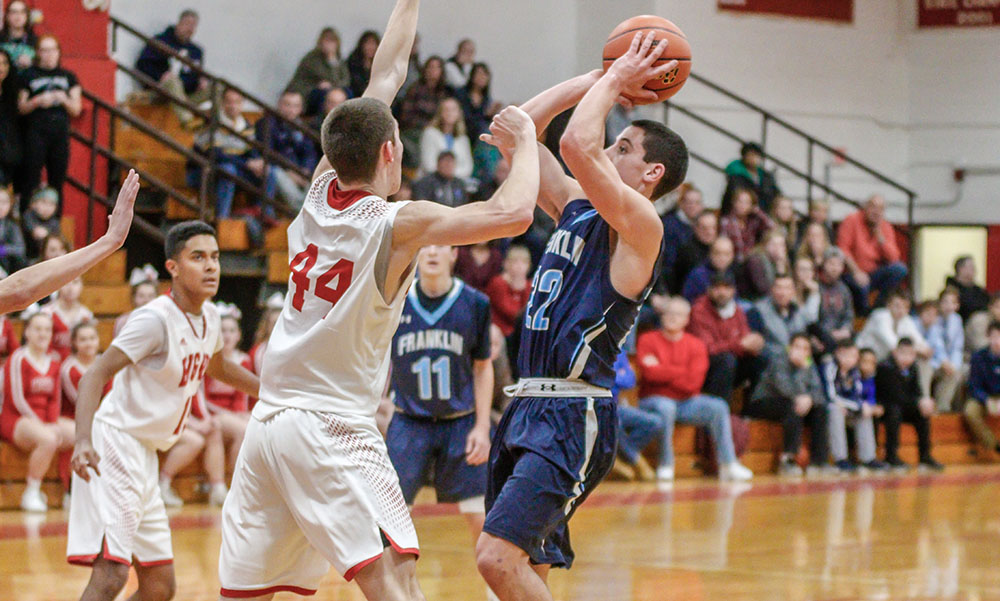 Franklin's Matt Elias (right) pulls up for a shot against North Attleboro's Jake Petersen. (Ryan Lanigan/HockomockSports.com)