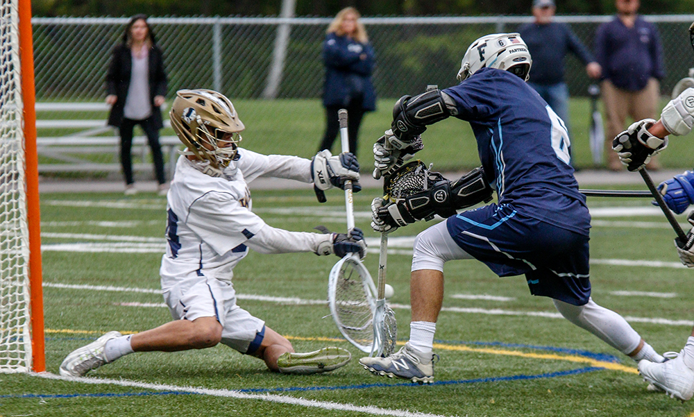 Foxboro goalie Jack Addeche (left) makes a save against Franklin's Eric Civetti in double overtime. (Ryan Lanigan/HockomockSports.com)