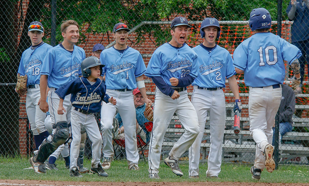Franklin's Jack Nally (10) is greeted by teammates following his home run in the second inning. (Ryan Lanigan/HockomockSports.com)