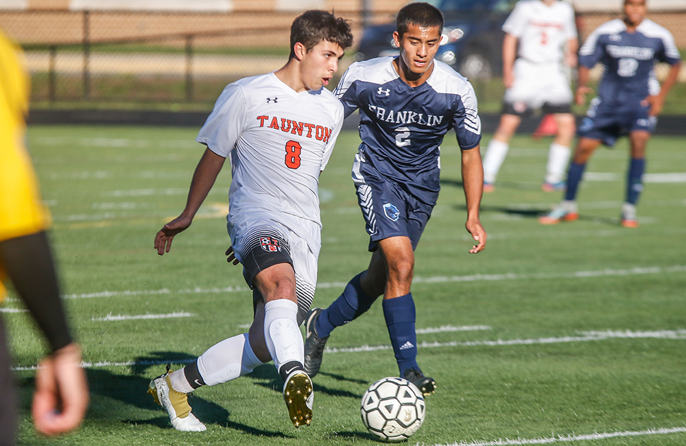 Taunton's Colby Fernandes and Franklin' Nitin Chaudhury battle for possession last season. (Ryan Lanigan/HockomockSports.com)