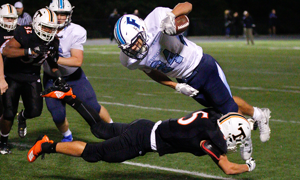 Franklin's Owen Palmieri (top) is tackled by Taunton's Max Moitoso. (Ryan Lanigan/HockomockSports.com)