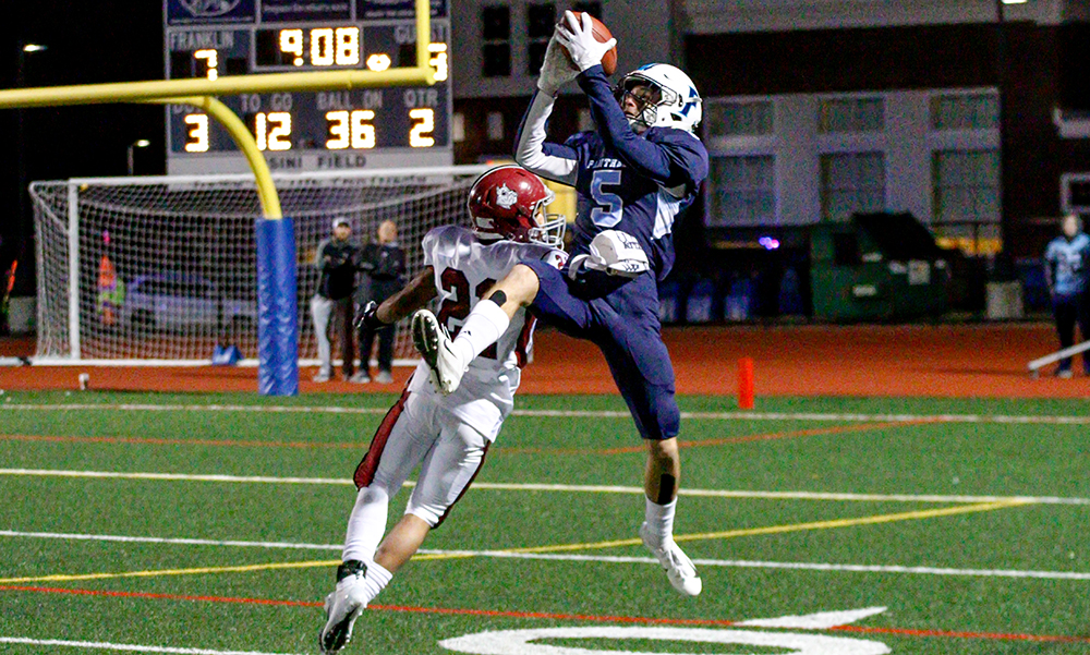 Franklin's Ryan Driscoll makes a leaping catch over a Brockton defender in the first half. (Ryan Lanigan/HockomockSports.com)
