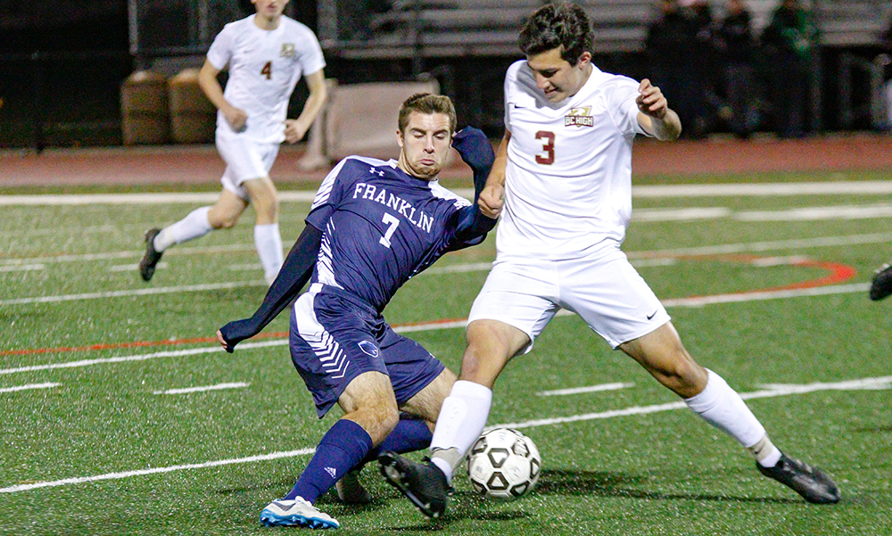 Franklin's Tim Duval makes a move past BC High's Brendan Kennedy in the second half. (Ryan Lanigan/HockomockSports.com)