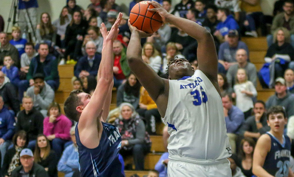 Attleboro's Qualeem Charles (right) goes up for a shot against Franklin's Sean Leonard in the second quarter. (Ryan Lanigan/HockomockSports.com)