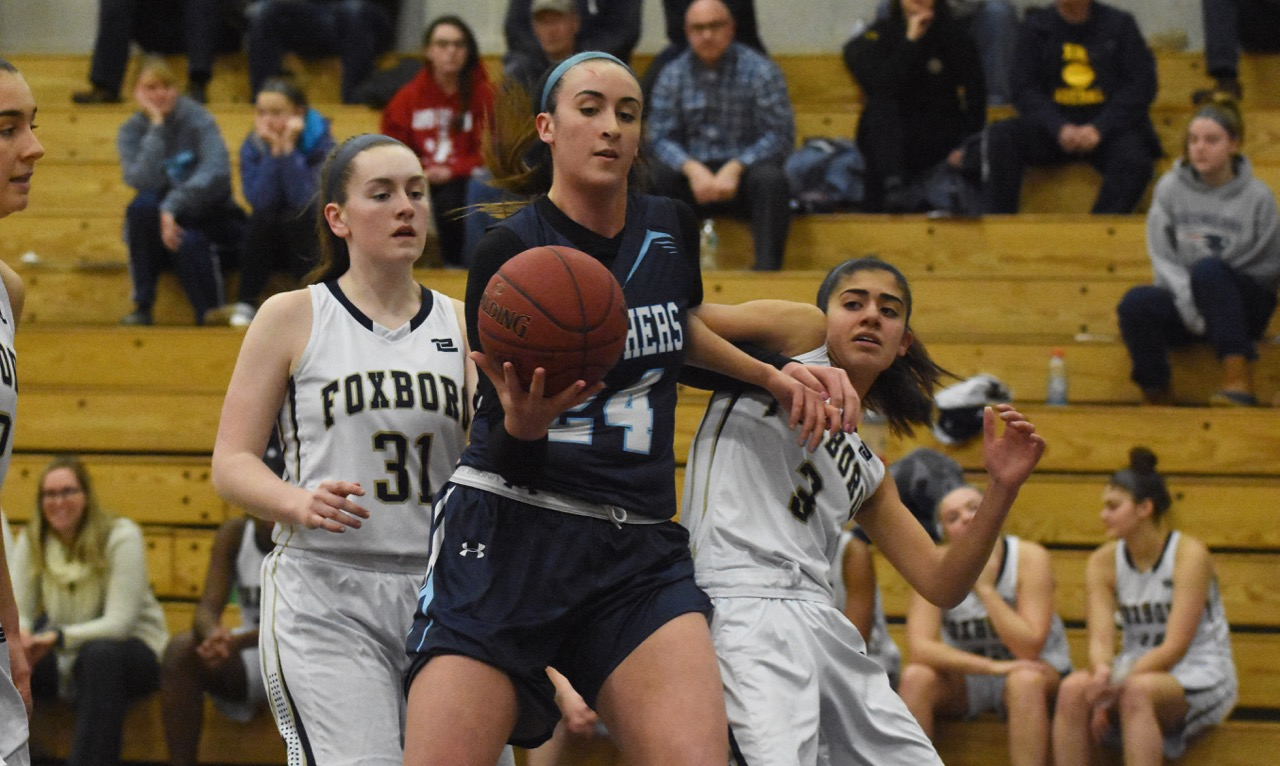 Franklin junior center Ali Brigham put up monster numbers (27 points, 15 rebounds, and six blocks) to end Foxboro's 26-game unbeaten run and keep the Panthers unbeaten in league play this season. (Josh Perry/HockomockSports.com)