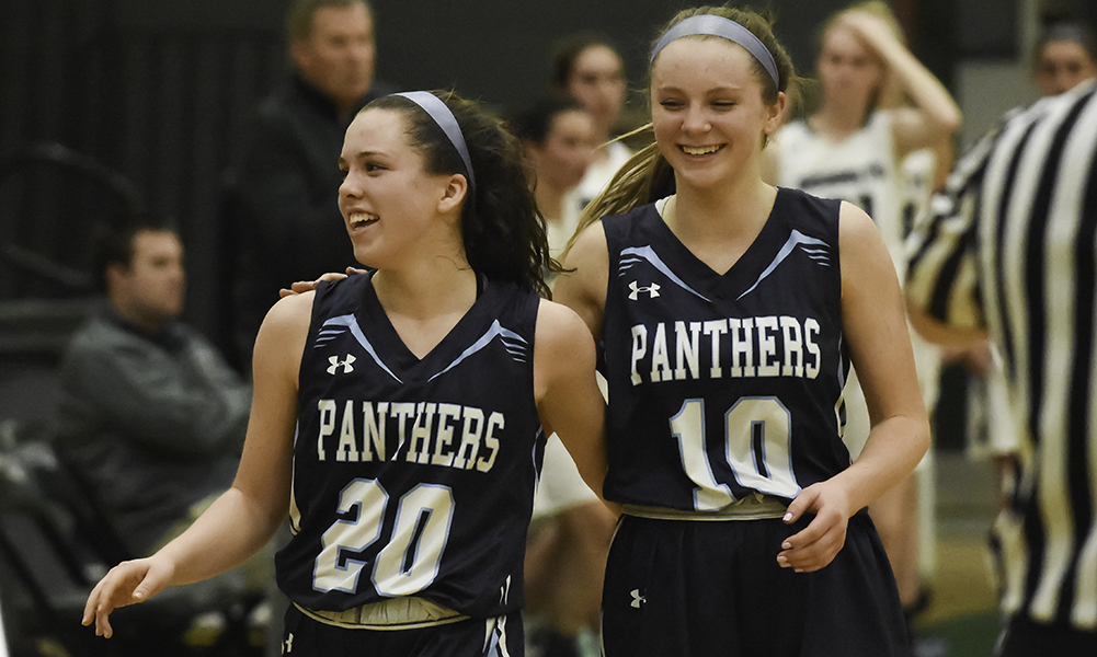 Erin Quaile (20) and Shannon Gray (10) were all smiles after beating Mansfield on the road to clinch at least a share of Franklin's first league title since 2013. (Josh Perry/HockomockSports.com)